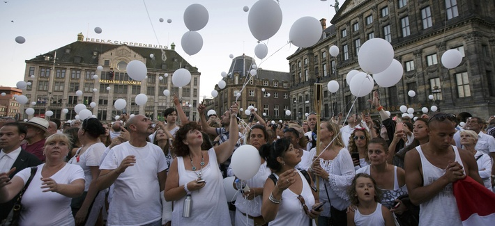 People attend a silent march of remembrance in Amsterdam for the victims of the Malaysia Airlines Flight 17 crash.