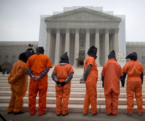Demonstrators in front of the Supreme Court dress as detainees to protest against the military's detention facility at Guantanamo Bay, Cuba.