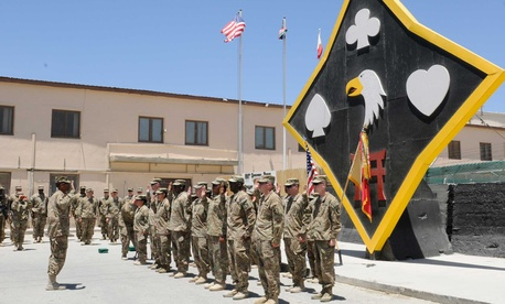 An Army colonel administers a reenlistment oath to soldiers assigned to Task Force Lifeliner at Bagram Airfield.