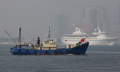 A Hong Kong fishing vessel carrying activists sets sail for the disputed Diaoyu Island in the East China Sea.