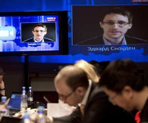 NSA leaker Edward Snowden asks a question to Russian President Vladimir Putin during a televised session, on April 17, 2014.