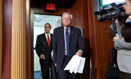 Senate Veterans' Affairs Committee Chairman Sen. Bernie Sanders, I-Vt., and House Veterans' Affairs Committee Chairman Rep. Jeff Miller, R-Fla., arrive for news conference on a breakthrough VA reform bill at Capitol Hill, in Washington, July 28, 2014.
