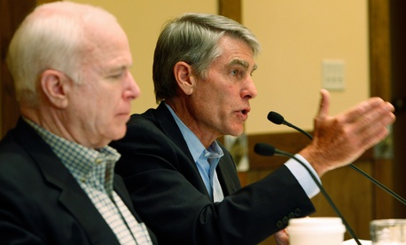 Sen. Mark Udall, D-Colo., right, speaks as Sen. John McCain, R-Ariz., listens at a Senate Field hearing on Aug. 24, 2009.