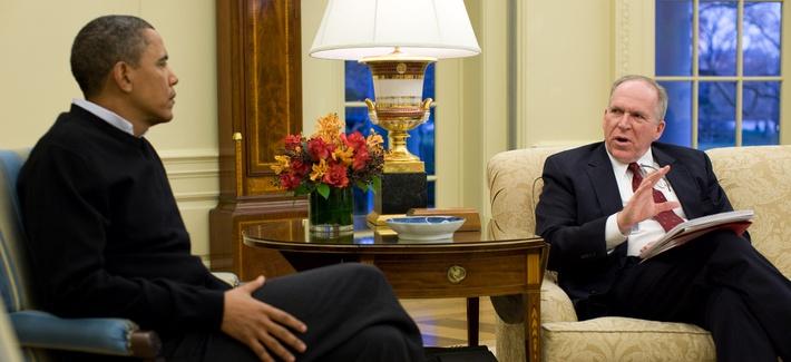 John Brennan briefs the President in the Oval Office.