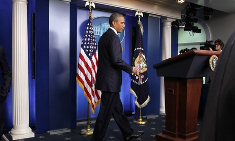 President Obama arrives to speak to reporters in the Brady Press Briefing Room, on August 1, 2014.