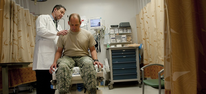 A physician at Tripler Army Medical Center performs a physical exam for a U.S. Air Force captain.