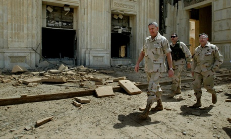 Gen. Tommy Franks walks outside the wreckage of Saddam Hussein's former palace near Baghdad in April, 2003.