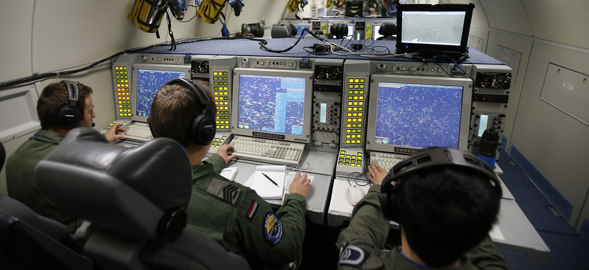 The E-3A AWACS Component crew of a NATO AWACS plane control computer and radar screens during a patrol over Romania and Poland, Friday, April 18, 2014.
