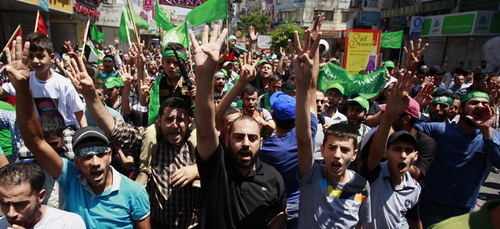 Supporters of Hamas and the Islamic Jihad movement chant slogans against the Israeli military action in Gaza, during a demonstration in the West Bank city of Jenin on Friday, Aug. 8, 2014.