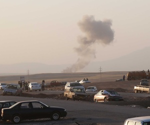 Smoke rises after air strikes targeting ISIL militants near the city of Irbil in northern Iraq, on August 8, 2014.