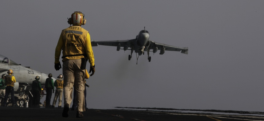 An EA-6B coming from a mission in Iraq lands on the deck of the USS George H.W. Bush on August, 10, 2014.