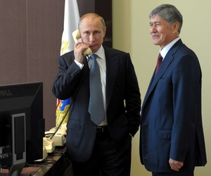 Russian President Vladimir Putin stands with Kyrgyzstan's President Almazbek Atambayev in Sochi, Russia, as he congratulates Turkish Prime Minister Recep Tayyip Erdogan for winning the Turkish Presidential Election, on August 11, 2014.