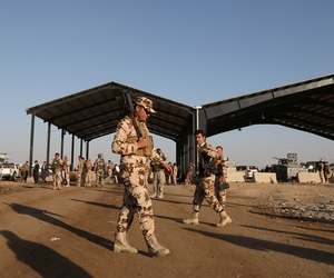 Kurdish Peshmerga fighters stand guard at the Khazer checkpoint outside of Irbil, Iraq, on August 8, 2014.