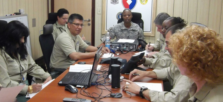 An Army lieutenant colonel with the Defense Contract Management Agency runs a staff meeting in DCMA Iraq, on May 17, 2012.
