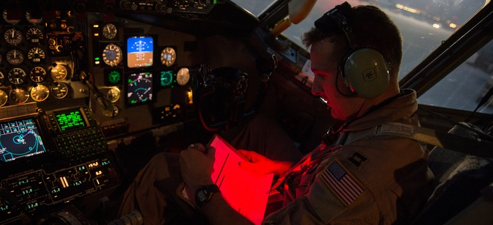 U.S. Air Force Capt. Trent Parker, 340th Expeditionary Air Refueling Squadron, KC-135 Stratotanker pilot, reads a pre-flight checklist prior to an in-air refueling mission over Iraq, Aug. 12, 2014.
