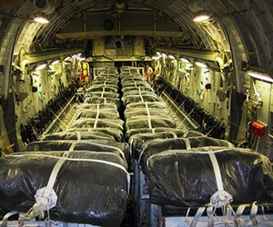 Pallets of bottled water are loaded aboard a U.S. Air Force C-17 Globemaster III aircraft in preparation for a humanitarian airdrop over Iraq, Aug. 13, 2014.