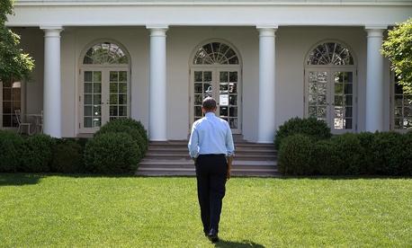 President Obama walks through the Rose Garden of the White House on May 6, 2014.