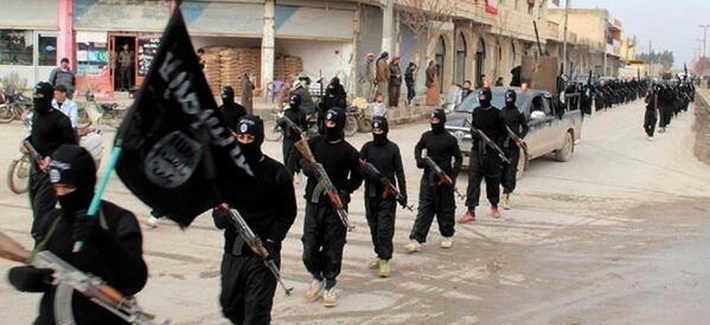 Fighters from ISIL march in Raqqa, Syria, on January 14, 2014.