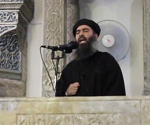 A screengrab from a militant website video Saturday, July 5, 2014, which has been authenticated based on its contents and other AP reporting, purports to show the leader of the Islamic State group, Abu Bakr al-Baghdadi, delivering a sermon at Iraq.