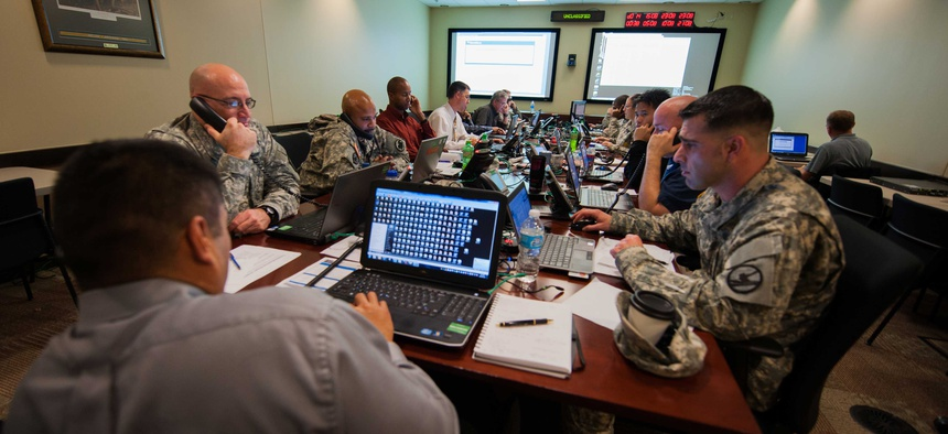 Computer tech support experts with the Army Reserve answer calls during an Enterprise Email Migration at U.S. Army Forces Command.
