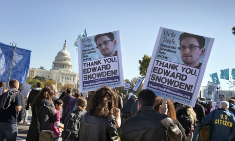Demonstrators rally at the Capitol to protest the NSA's surveillance programs.