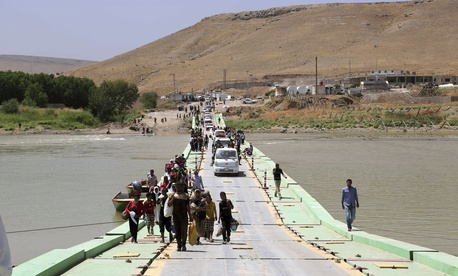 Displaced Iraqis from the Yazidi community arrive at Nowruz camp, in Derike, Syria, on August 10, 2014.