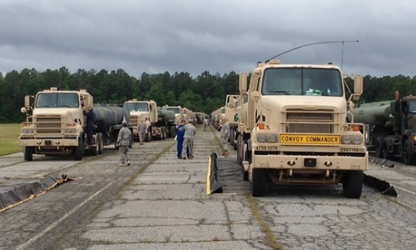 M915A5 line-haul tractor trucks line up at Fort Lee, Va., and prepare for a convoy to Fort A.P. Hill, Va., on June 3, 2013.