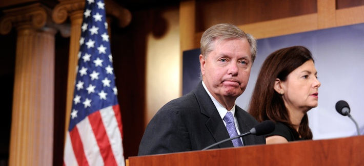 Sen. Lindsey Graham, R-S.C., left, and Sen. Kelly Ayotte, R-N.H., right, walk off of the stage following a news conference on the violence in the Mideast on Capitol Hill in Washington, July 24, 2014.