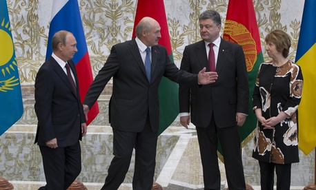 Belarusian President Alexander Lukashenko welcomes Russian President Vladimir Putin, Ukrainian President Petro Poroshenko and EU foreign policy chief Catherine Ashton, on Tuesday.