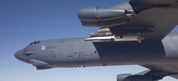 An X-51A Waverider test vehicle is attached to a B-52H Stratofortress prior to a test over the Pacific Ocean.