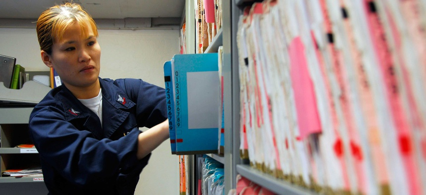 A Petty Officer files medical records aboard the USS Nimitz.