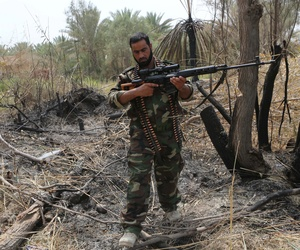 An Iraqi Shiite fighter clashes with Islamic State militants in Jurf al-Sakhar, 43 miles south of Baghdad, on August 18, 2014.