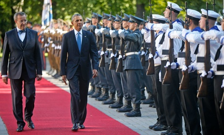 President Obama reviews the honor guard with Estonian President Toomas Hendrik Ilves during a visit, on September 3, 2014.