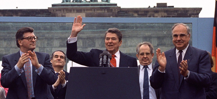 President Reagan acknowledges the crowd after delivering a speech in front of the Brandenburg Gate in West Berlin, on June 12, 1987.