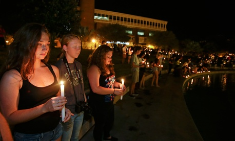Supporters take part in a candle light vigil at the University of Central Florida, Sept. 3, 2014, in Orlando, Fla., to honor Steven Sotloff, a UCF former student and the second American journalist to be beheaded by the Islamic State group in two weeks.
