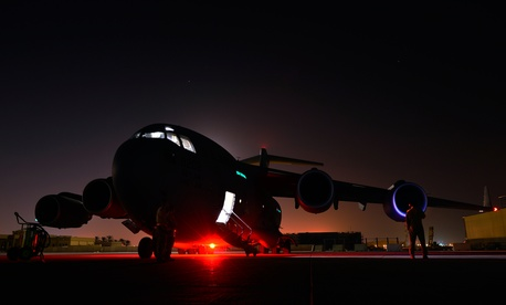 A U.S. Air Force  C-17 Globemaster III crew chief awaits engine start prior to a humanitarian airdrop mission over Amirli, Iraq, Aug. 30, 2014.