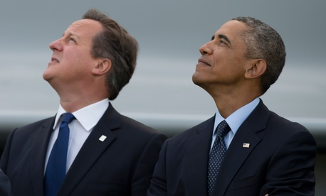 U.S. President Barack Obama and British Prime Minister David Cameron watch a flypast at the NATO summit at the Celtic Manor Resort in Newport, Wales on Sept. 5, 2014.