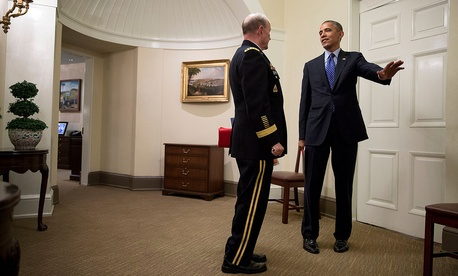 President Obama speaks with Joint Chiefs Chairman Gen. Martin Dempsey after a meeting in the Situation Room on July 19, 2014.