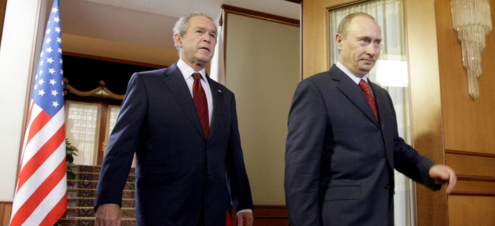 Former President George W. Bush walks with Russian President Vladimir Putin at the Bocharov Ruchei presidential residence in Sochi, on April 6, 2008.