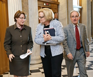 Sens. Amy Klobuchar, D-Minn, Claire McCaskill, D-Mo., and James Risch, R-Idaho, arrive for a vote on Capitol Hill.