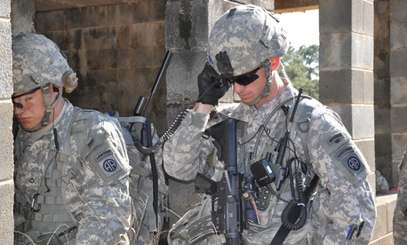 Paratroopers from the 3rd Brigade Combat Team, 82nd Airborne Division use Joint Tactical Radio System radios to communicate during an exercise at Fort Bragg, N.C.
