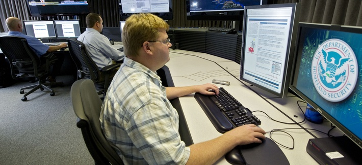 """A cyber security analyst works in the """"watch and warning center"""" during a tour of the government's cyber defense lab in Idaho Falls, Idaho."""