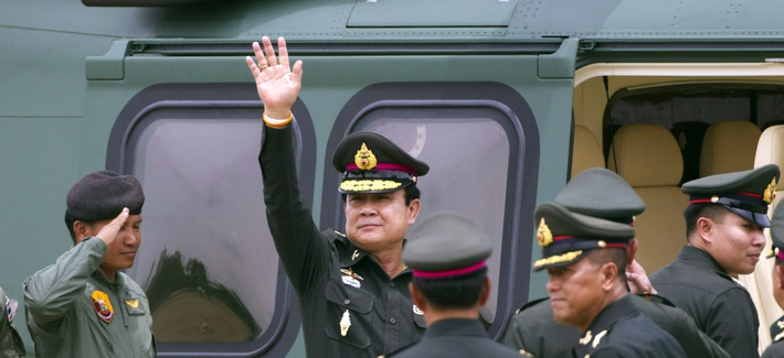 The new Thai Prime Minister Prayuth Chan–ocha waves after attending a ceremony in Thailand's Chonburi Province on August 21, 2014.