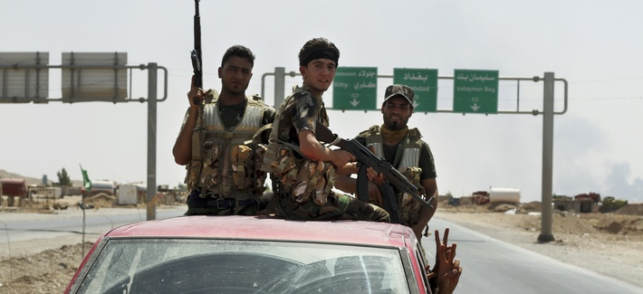 Shiite militiamen, on August 31, 2014, patrol in Amerli, Iraq, after breaking a siege by the Islamic State on the town.
