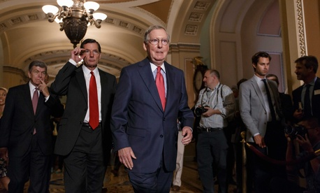Senate Minority Leader Mitch McConnell, R-Ky., leads fellow senators to a news conference on Capitol Hill on Tuesday.