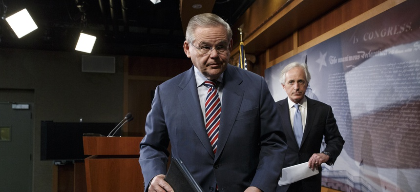 Senate Foreign Relations Committee Chairman Sen. Robert Menendez, D-N.J., and Sen. Bob Corker, R-Tenn., finish a news conference on Capitol Hill on March 27, 2014.