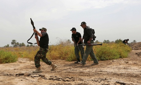 Shiite fighters prepare to take positions in a battle against Islamic State militants.