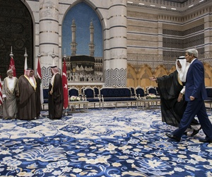 U.S. Secretary of State John Kerry, right, arrives for a group photo after a meeting with Gulf states and other Middle East countries in Jiddah, Saudi Arabia, Sept. 11, 2014.