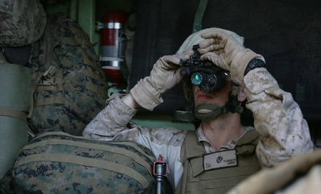 Cpl. Dustin Turner, a rifleman with the 1st Platoon, Company G, adjusts his night vision optics while riding in an Amphibious Assault Vehicle.
