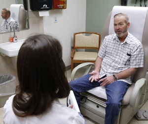 A veteran speaks with a physician at the Veterans Administration Medical Center in Oklahoma City, Okla., on June 12, 2014.